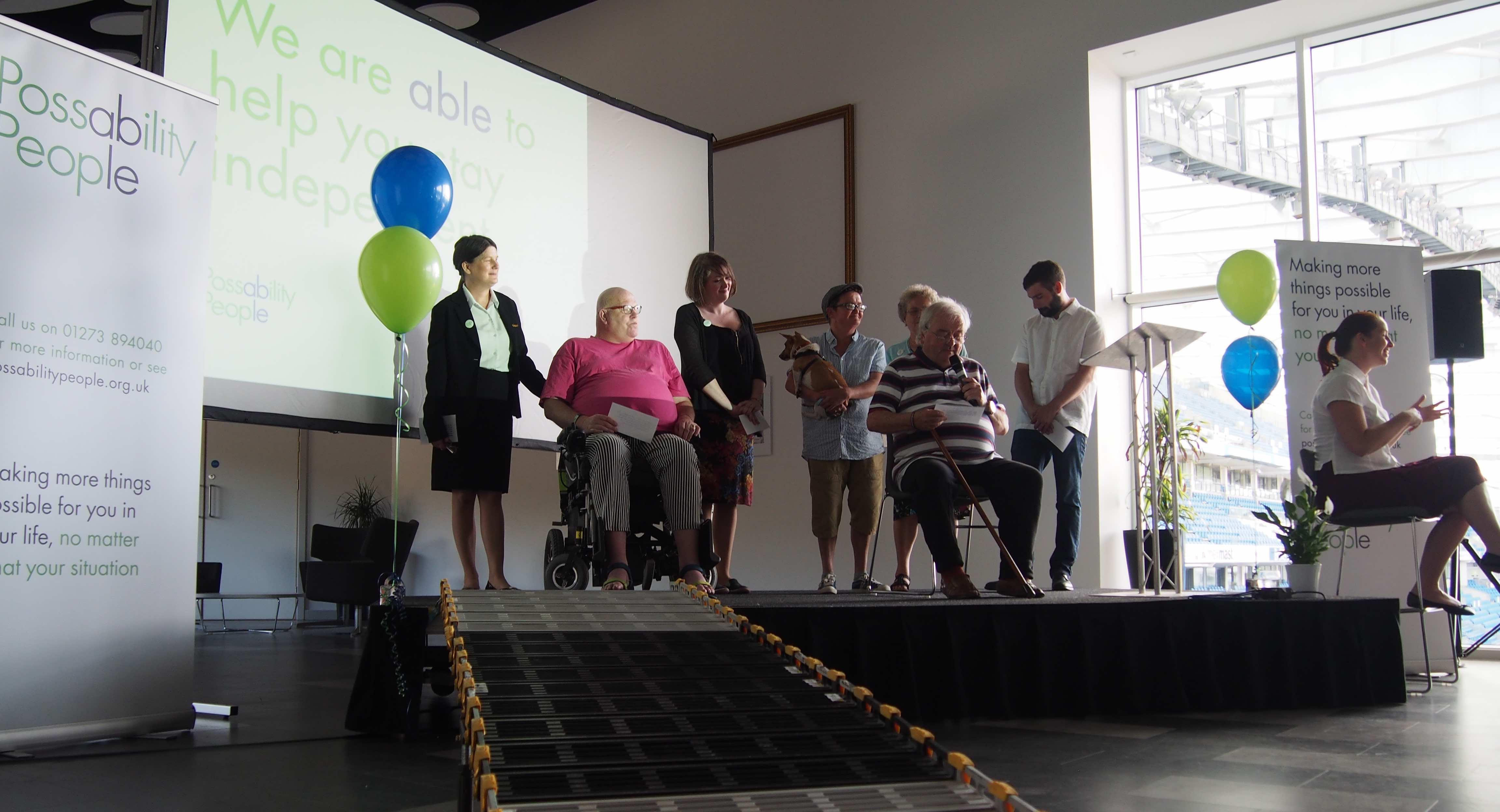Trustees and volunteers on stage