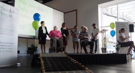 Staff, trustees and volunteers on stage at the launch of Possabiity People